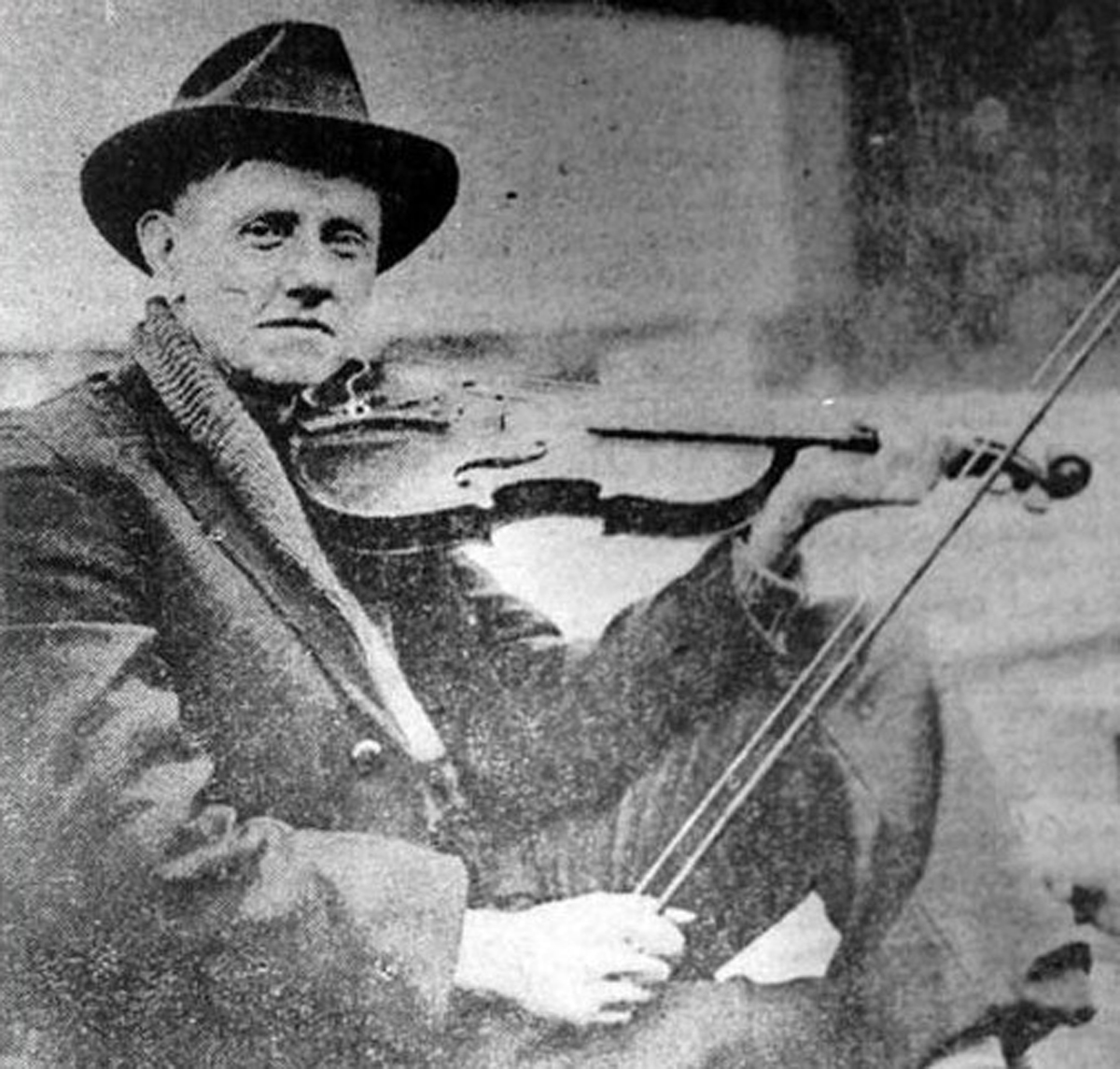"John Carson was born near Fannin County, Georgia in 1868. He learned to play the fiddle at a young age and began performing in the streets for tips. In 1914, while working in a textile mill, workers of the mill went on strike. During the strike he began playing and selling songs in the streets of North Atlanta. On April 1, 1913, Carson performed at the first annual ""Georgia Old-Time Fiddlers' Convention"" coming in fourth. Over the years he was considered ""Champion Fiddler of George"" seven times and acquired the ""Fiddlin'"" part of his name by the governor of Tennessee. In September 1922, Carson made his radio debut at the Atlanta Journal radio station WSB and in June 1923, Carson made his recording debut in an empty building on Nassau Street in Atlanta. He cut two sides to the record, ""The Little Old Log Cabin in the Lane"" and ""The Old Hen Cackled and the Rooster's Going To Crow."" This record is considered to be the first country song recorded with vocals and lyrics. Carson recorded almost 150 songs between 1923 and 1931. He wrote more than 150 songs in his life, but only nine were ever copyrighted."