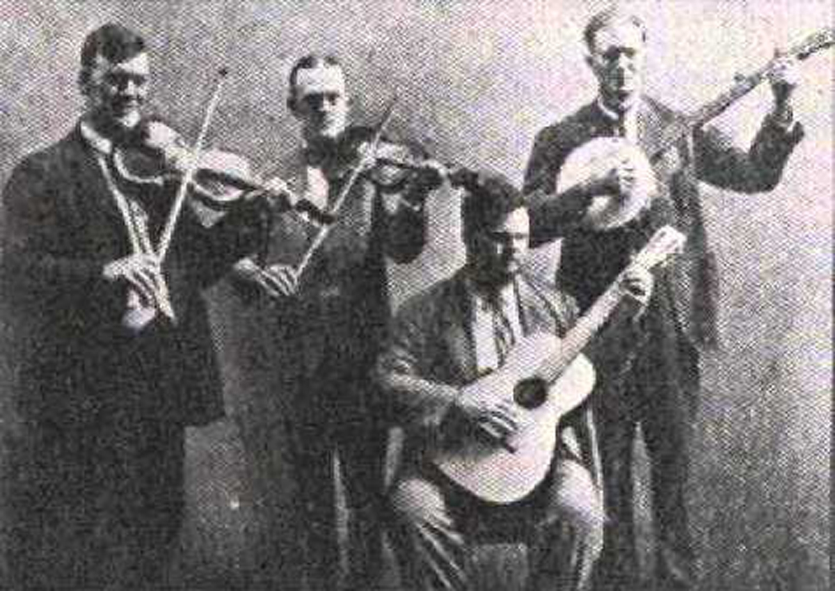 "In 1926, talent scout Frank Walker recorded a group of musicians from the Atlanta area that have since been declared ""Country Music's First Supergroup"". Walker took the ever popular Gid Tanner from Dacula, Riley Puckett from Alpharetta, Clayton McMichen from Altoona and Fate Norris from the Dalton area, and dubbed them ""The Skillet Lickers"". Each member filled a very important role in the group. Gid Tanner was the ""cut up"" or the entertainer of the group. McMichen was the polished musician while Puckett was considered a singer's singer. Norris kept the rhythm steady. Other musicians such as Lowe Stokes, Bert Layne, Ted Hawkins and Gordon Tanner contributed to their early success, as well. The Skillet Lickers seemed to have struck a nerve with rural Americans. They recorded songs that were already known, many of which were already in public domain. The Skillet Lickers performed and recorded those old songs with an all-new energy that no one, even to this day, could match. For five years, the Skillet Lickers proved to be one of Frank Walker and Columbia Records' biggest success stories for their ""rural"" or ""hillbilly"" classification of music. Their success also had an influence on other legendary musicians like Jimmie Rodgers, Roy Acuff, Bob Wills, Merle Travis, Hank Williams and many others."