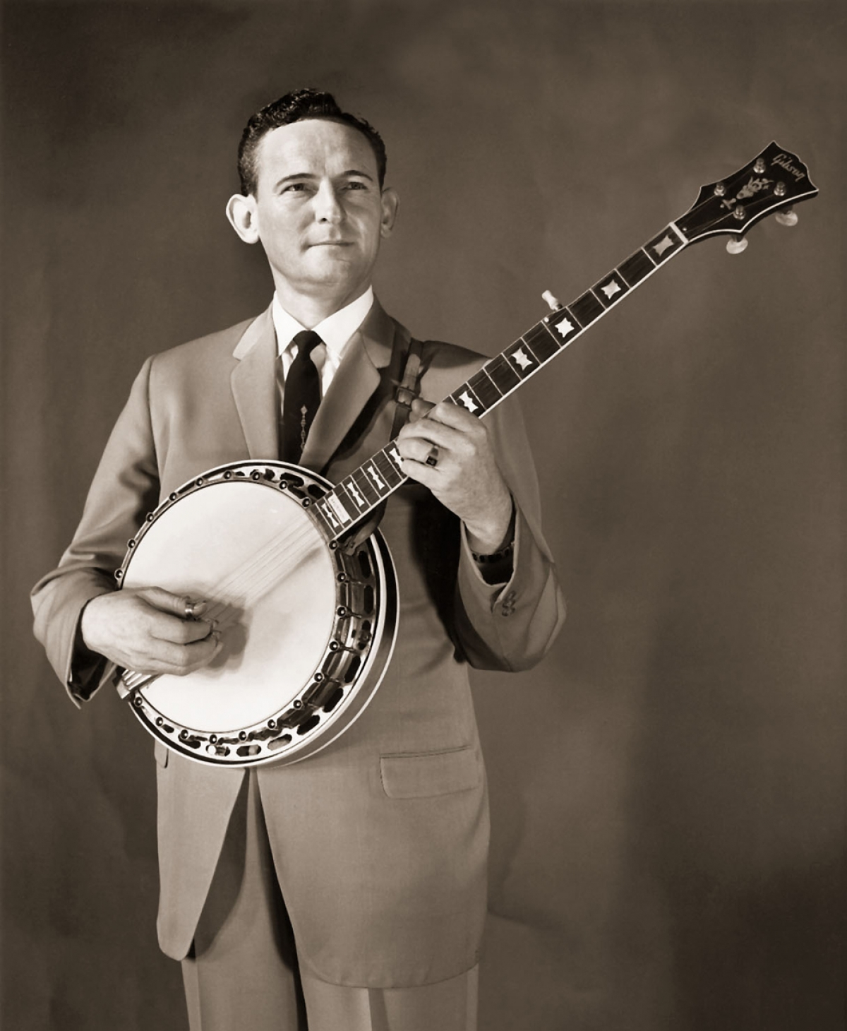 "Born in Spartanburg, SC in 1927, Don Reno was a bluegrass banjo pioneer whose style was widely admired.  In 1948 Reno became a member of Bill Monroe's Bluegrass Boys.  Two years later with Red Smiley, he formed ""Reno and Smiley and the Tennessee Cutups"", a partnership that lasted fourteen years and recorded over 100 influential albums.  In 1964, after the retirement of Red Smiley, Reno and guitarist Bill Harrell formed ""Reno and Harrell"" followed by a solo career that lasted until his death in 1984.  Reno accompanied Arthur Smith on Smith's well-known recording of ""Feuding Banjos""."